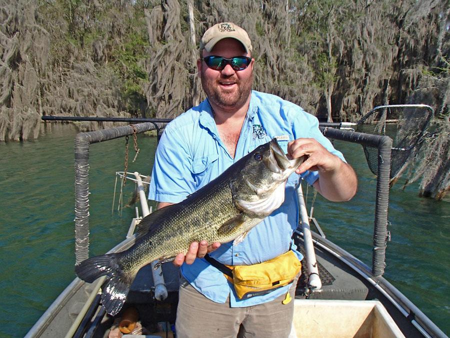 Biologist holds a Merritt's Mill Pond quality largemouth bass